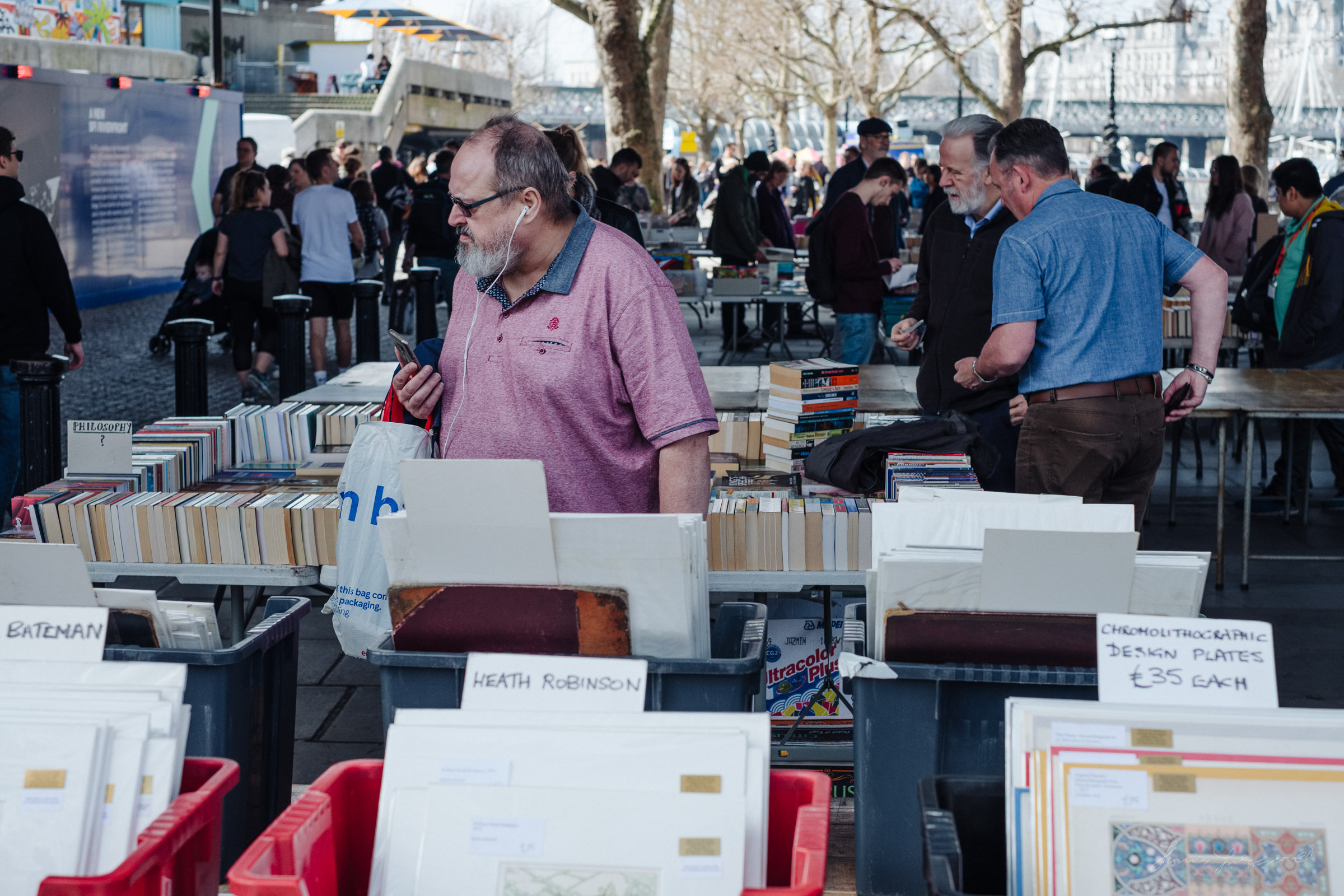 Man browsing second hand book market in London