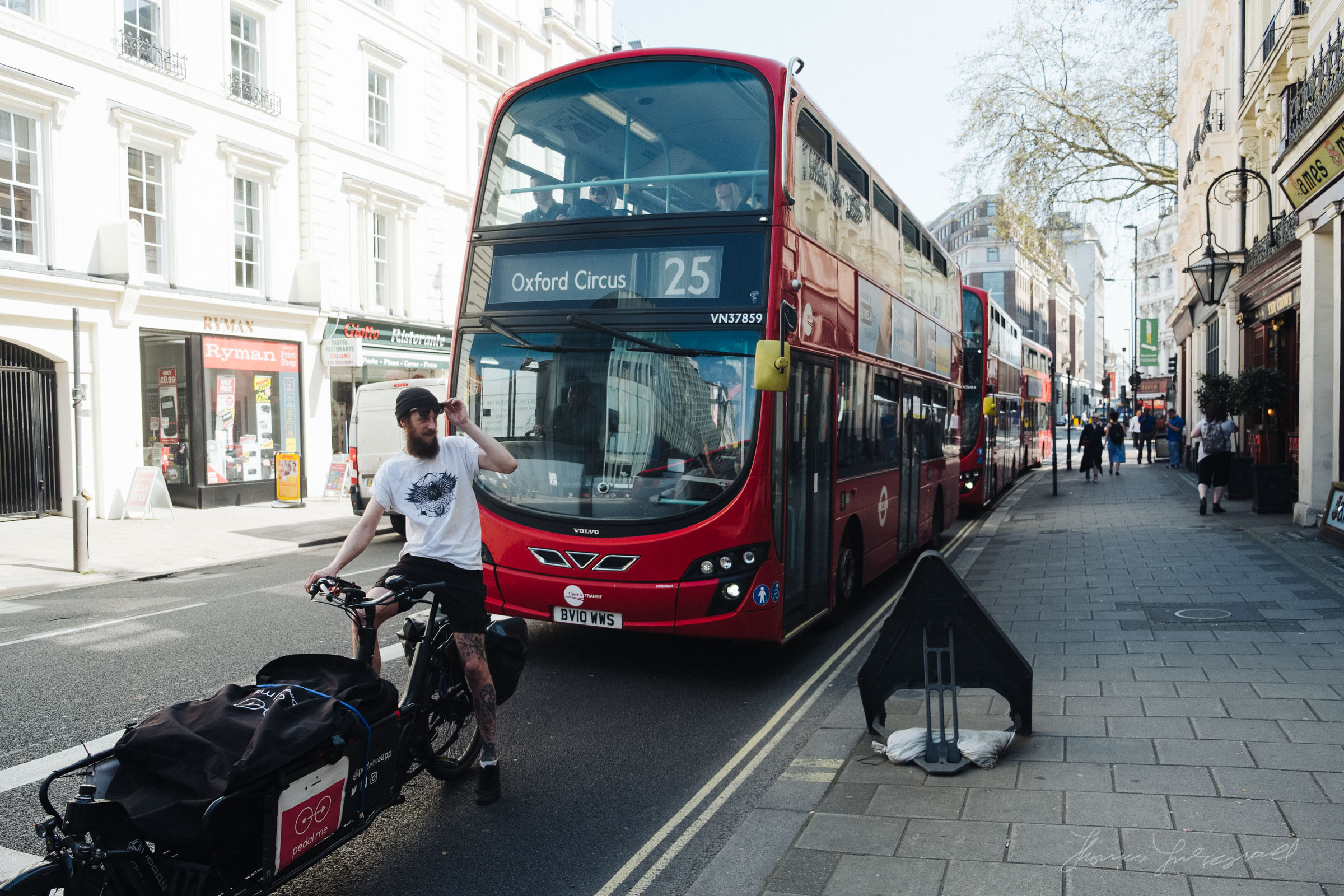 Cyclist and Red Doubledecker bus in London
