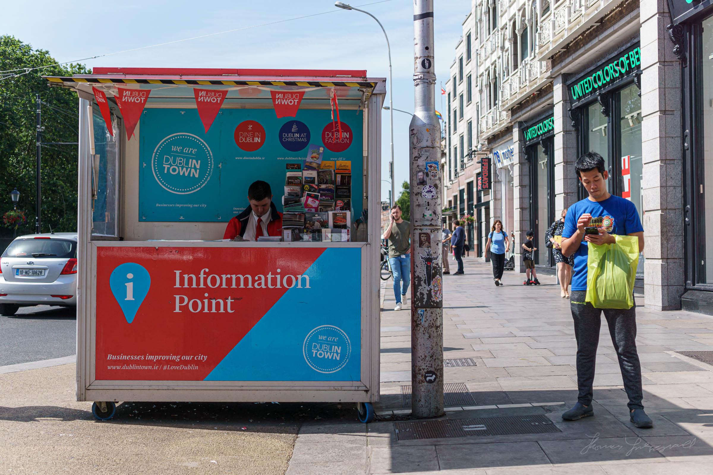 Man standing beside Dublin Tourist Information