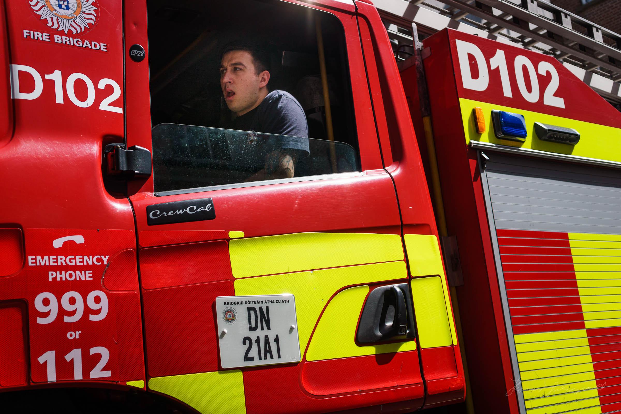 Fireman inside a fire engine