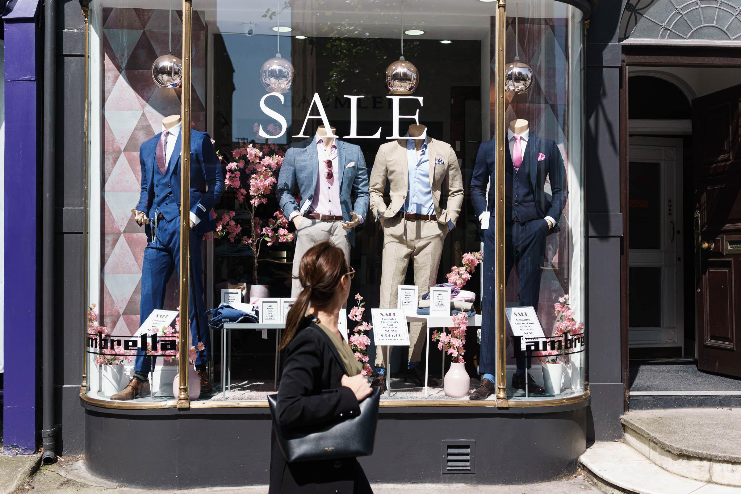 Woman looks in the window of a store in Dublin