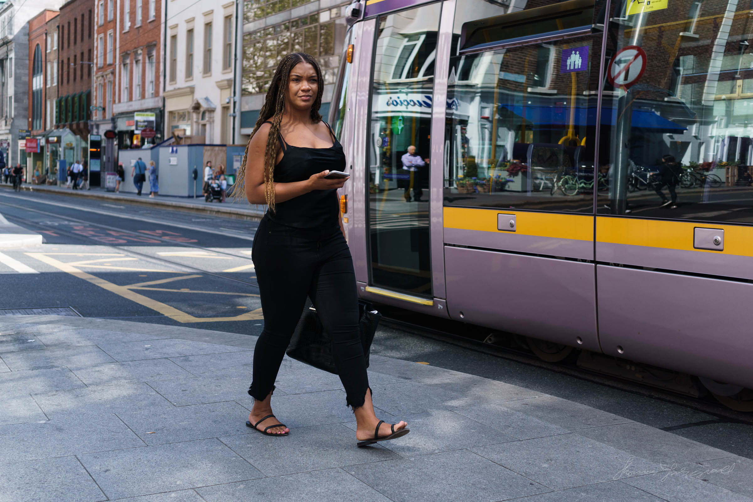 Woman walking by the Luas