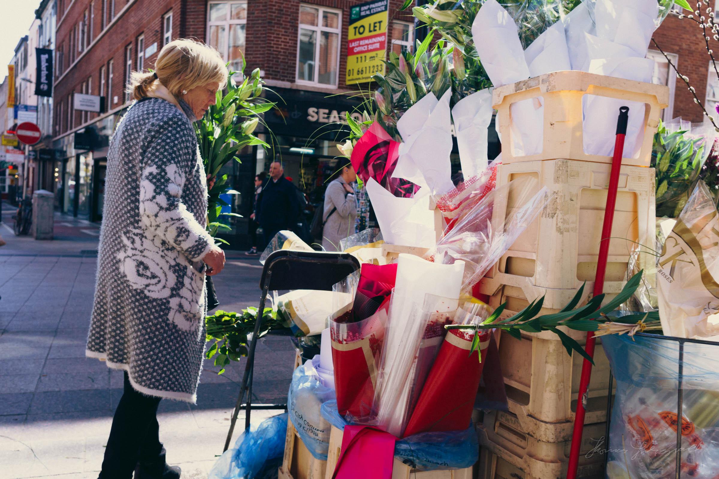 Flower seller inspecting wares