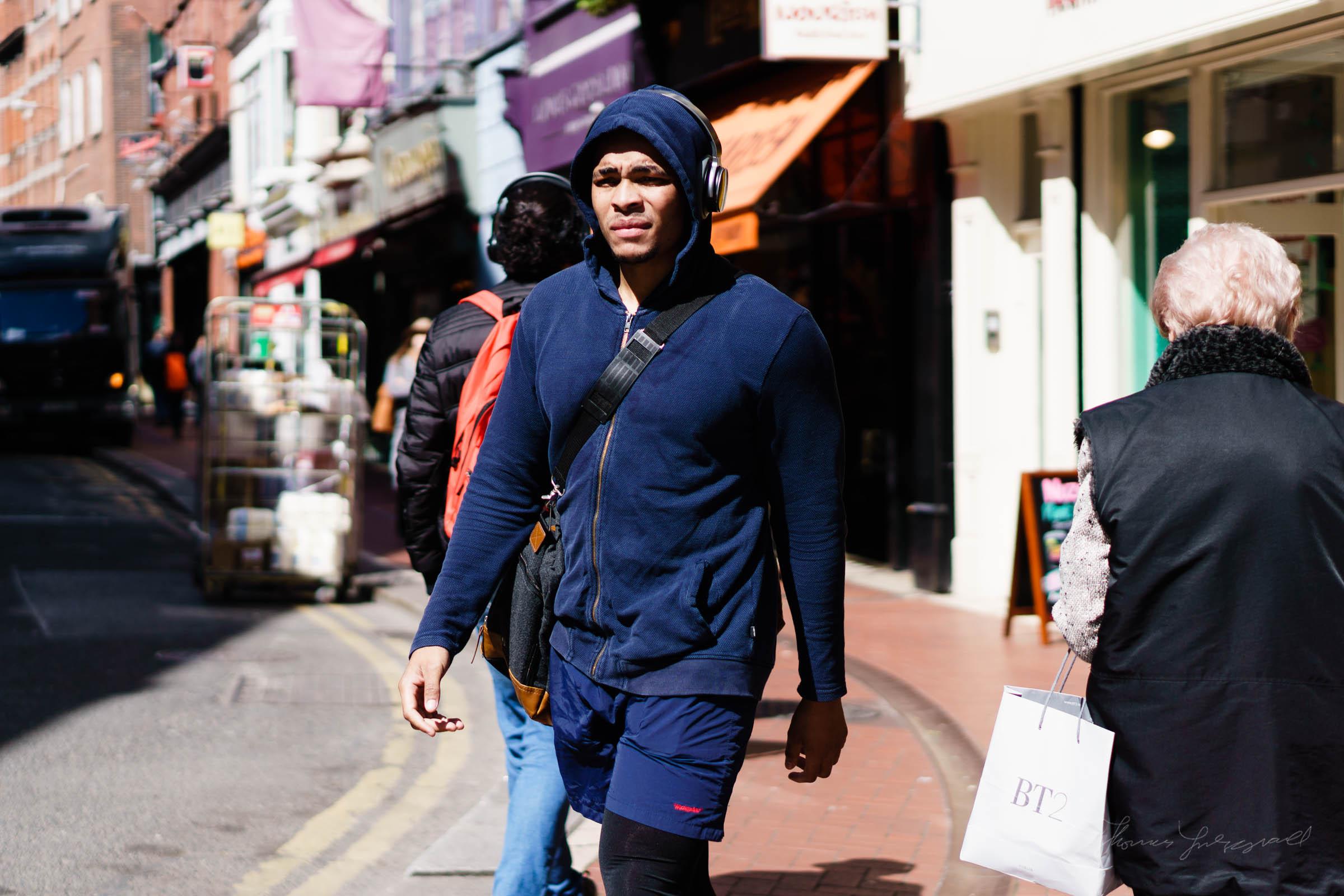 Man in a hoodie wearing headphones - Street Photography in Dubli