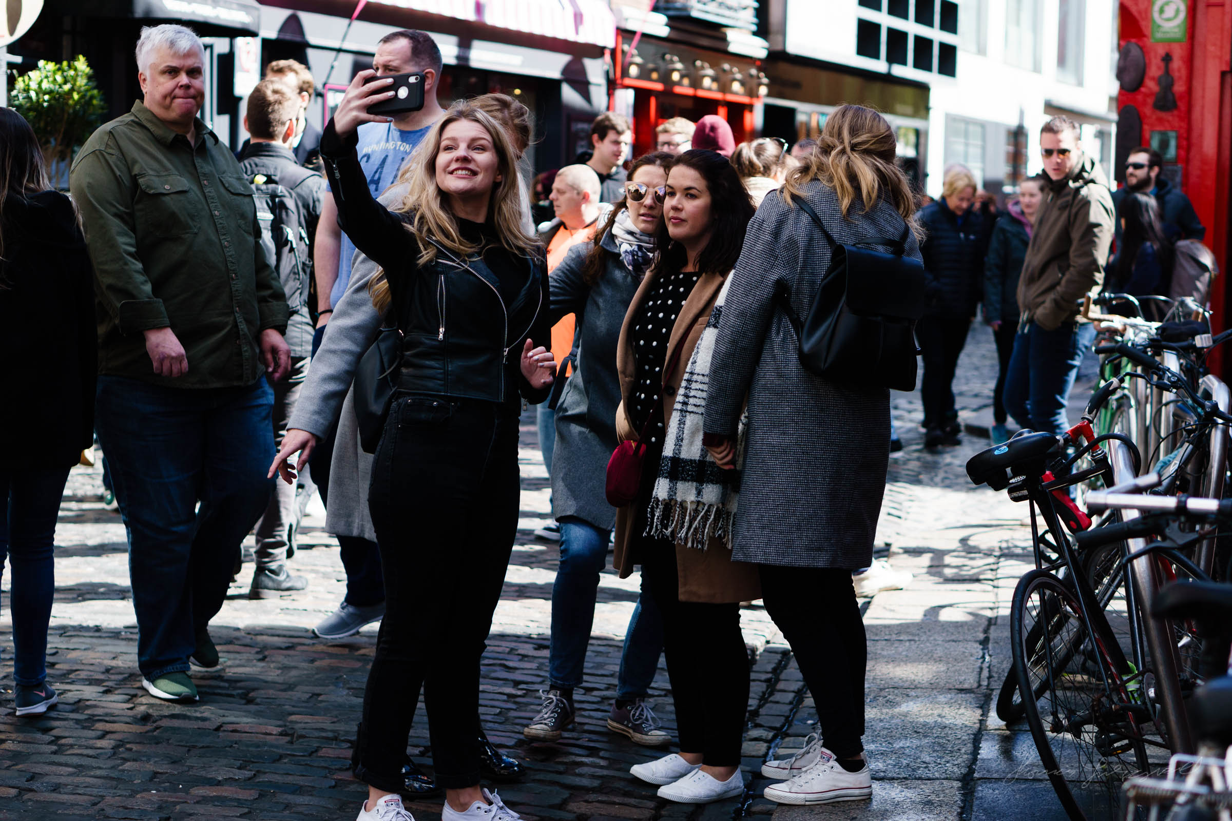 group taking selfies  - Street Photography in Dublin
