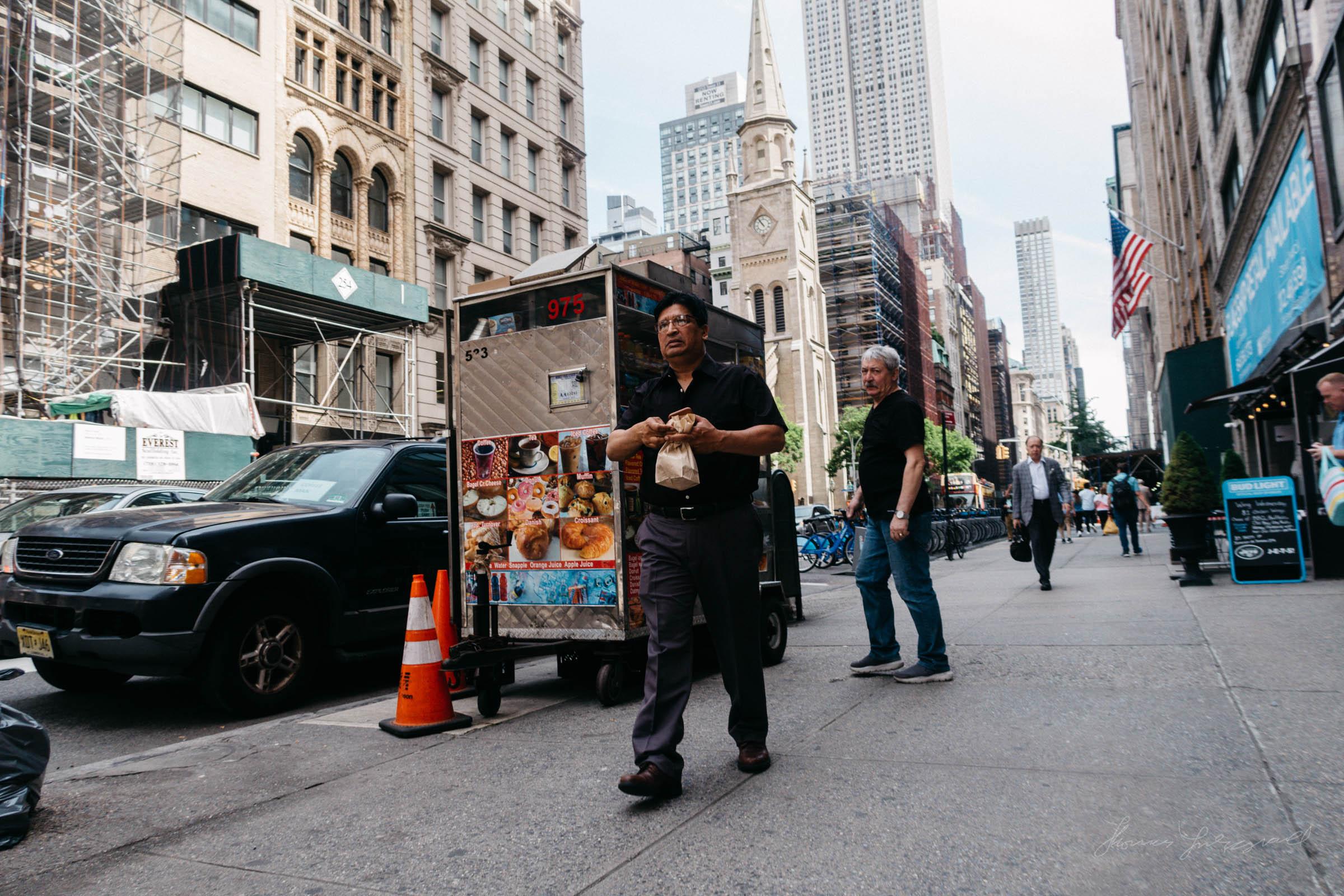 Guy walking on 5th Avenue, NYC