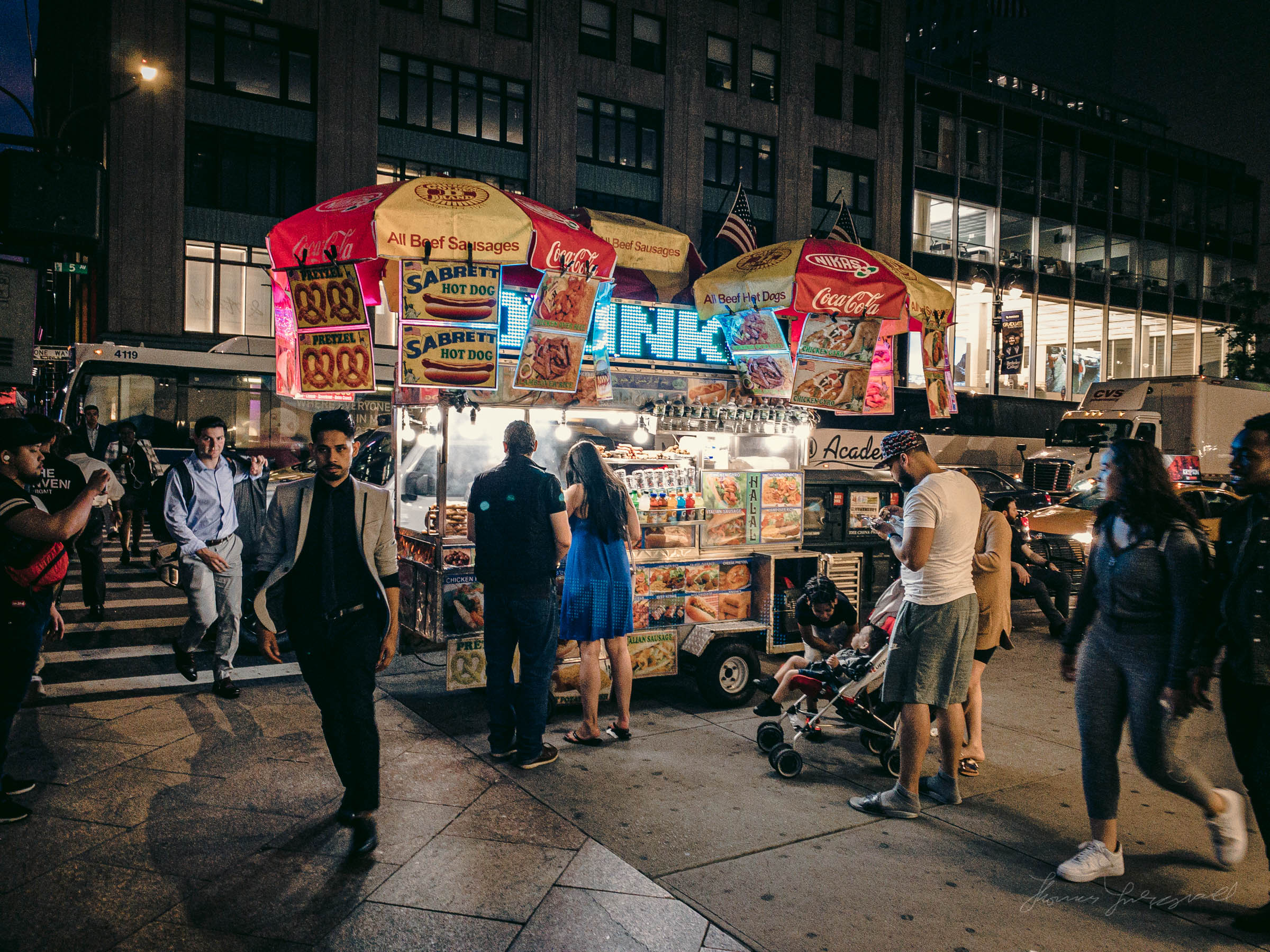 Hot Dog vendor on 5th Avenue at Night in NYC