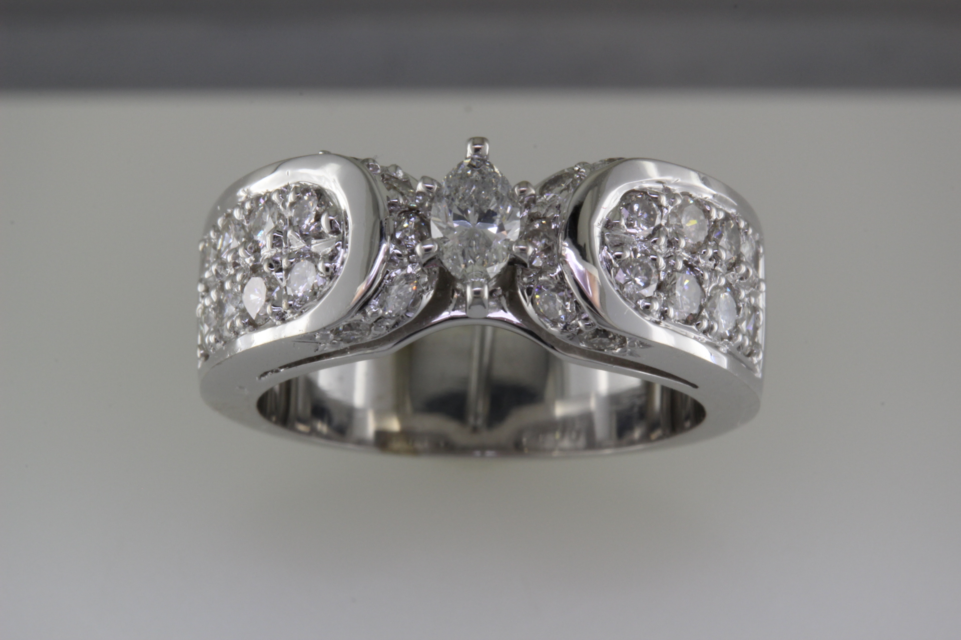 Crafted ring using customer's diamonds.