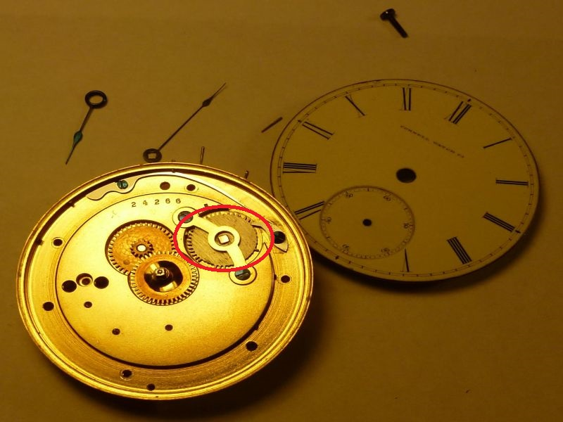 Disassembled Cornell pocket watch. Broken gear circled in red.