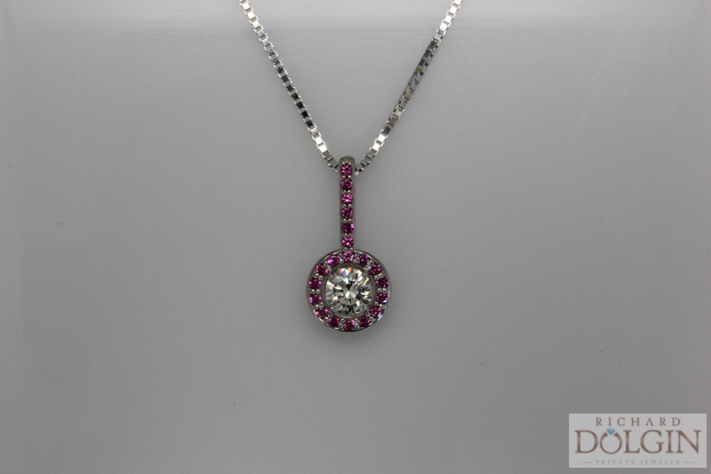 Diamond pendant with pink sapphire accent