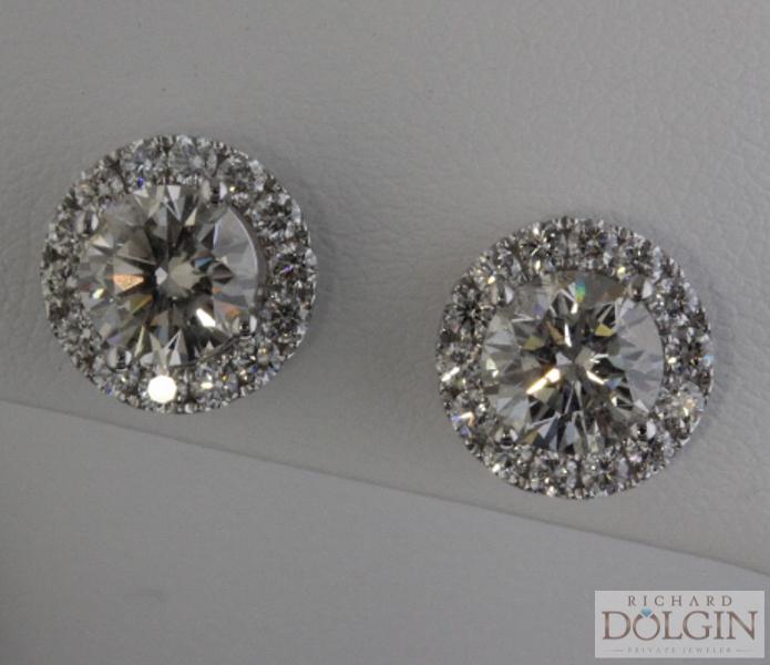 Diamond solitaire earrings in jackets