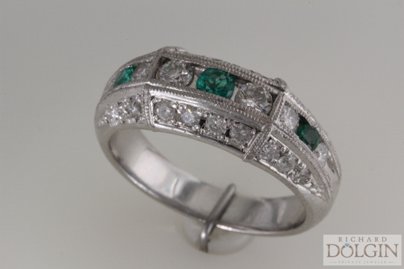 Platinum emerald and diamond band