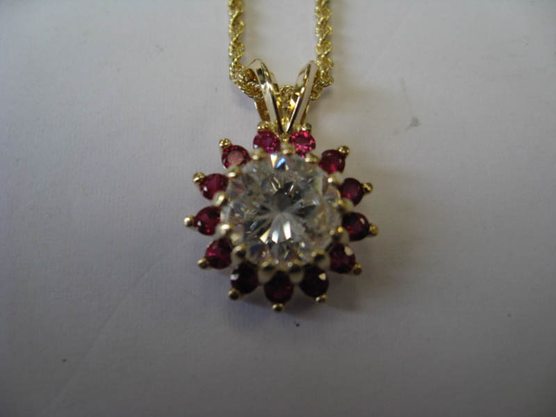 Diamond pendant surrounded by rubies