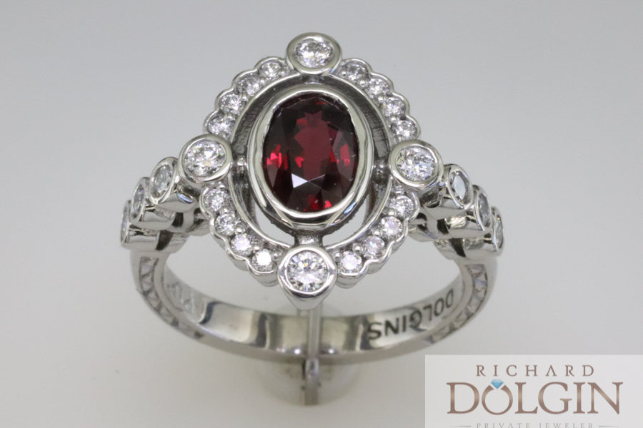 Finished ruby ring with side diamonds