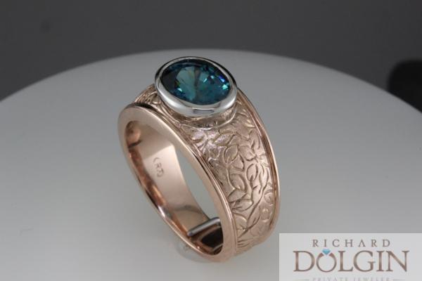 Blue zircon set in rose gold