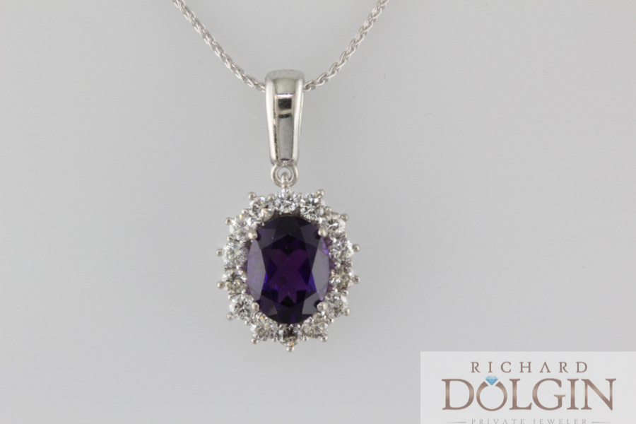Oval amethyst and diamond pendant
