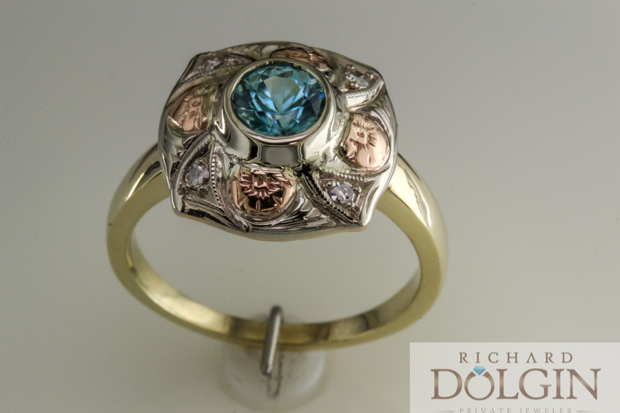 Antique blue zircon ring accented with rose gold