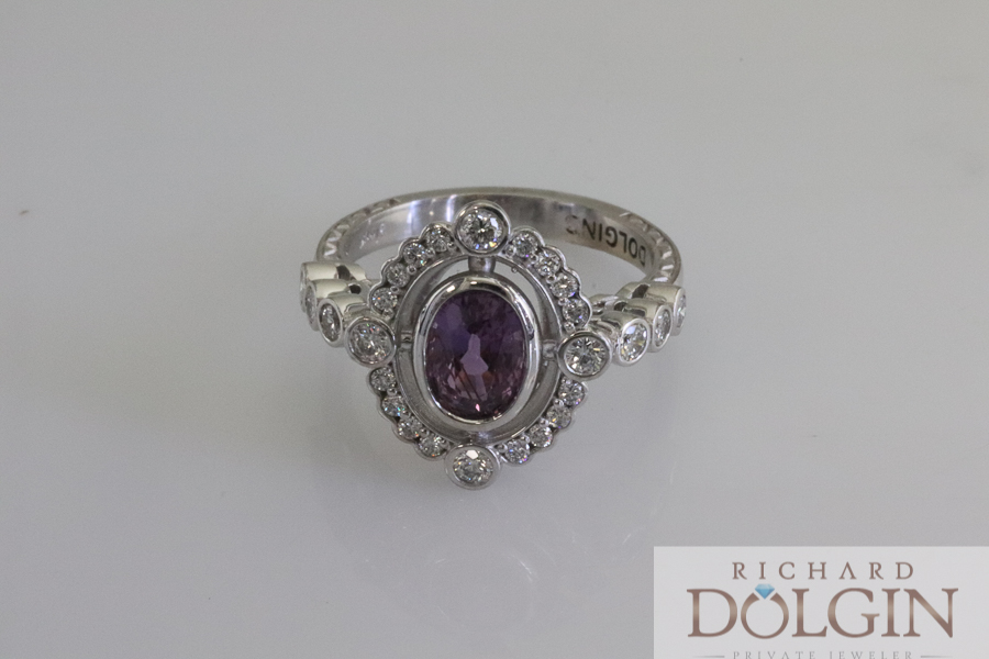 Purple sapphire set in white gold engagement ring