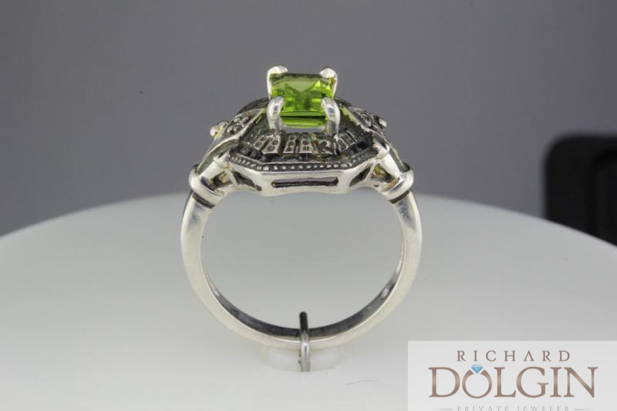 Peridot set in antique style mounting