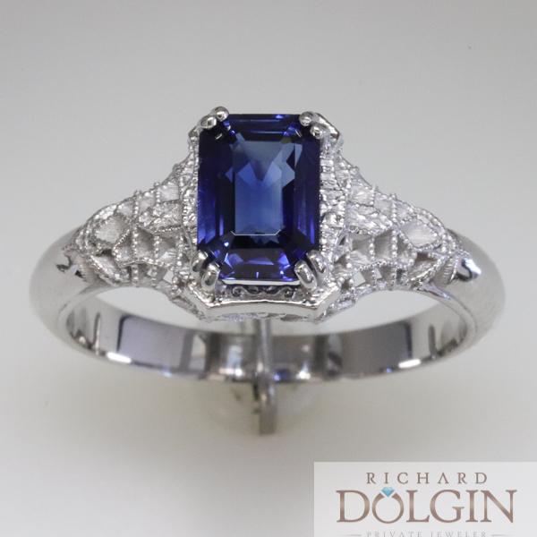 Emerald cut sapphire in filigree ring