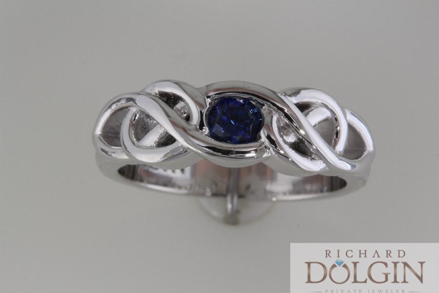 Blue sapphire in Celtic design wedding band
