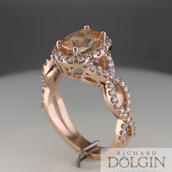 Side view of peach sapphire ring in rose gold