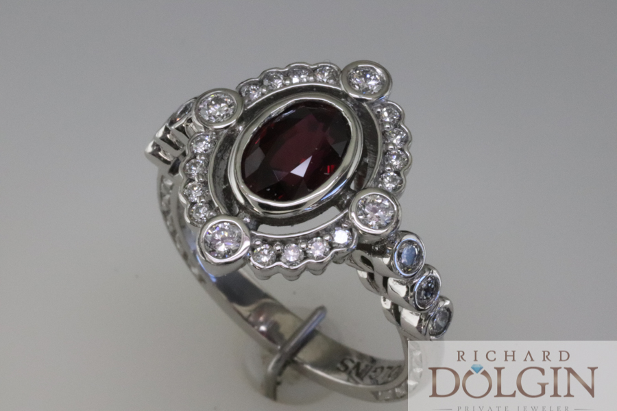 Ruby ring with accented halo