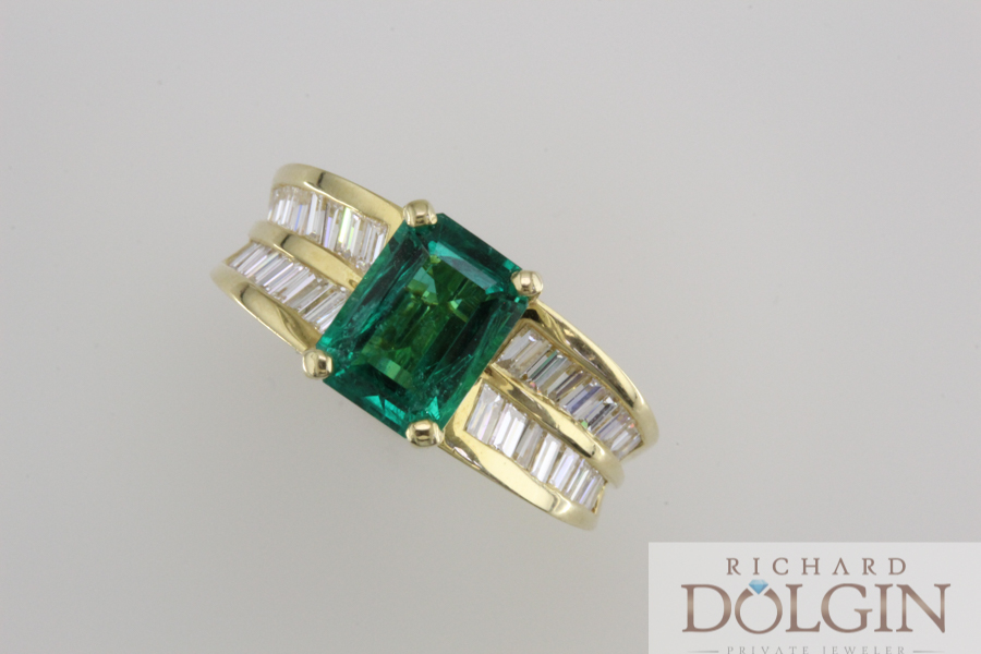 Emerald ring with baguette accents