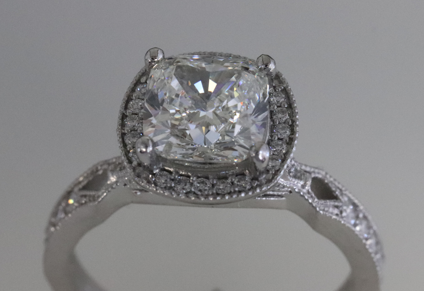 Cushion cut in halo diamond ring