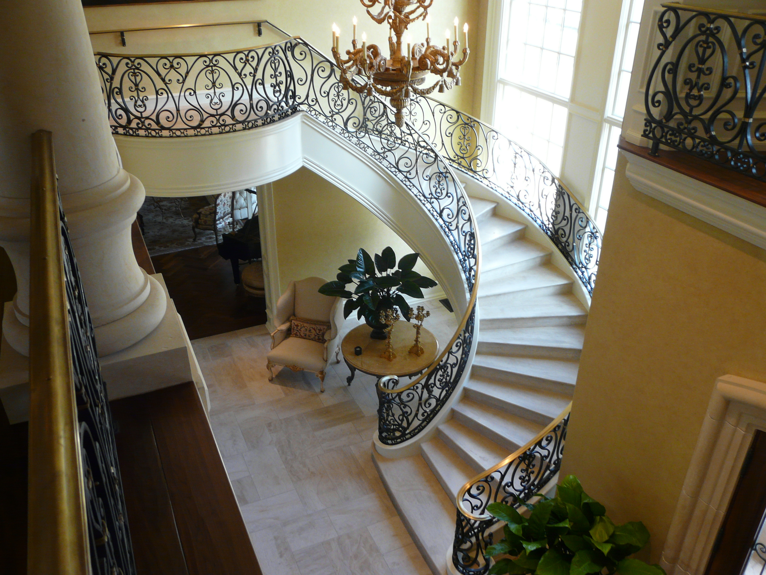 Curved Staircase Railing with Brass Cap Rail