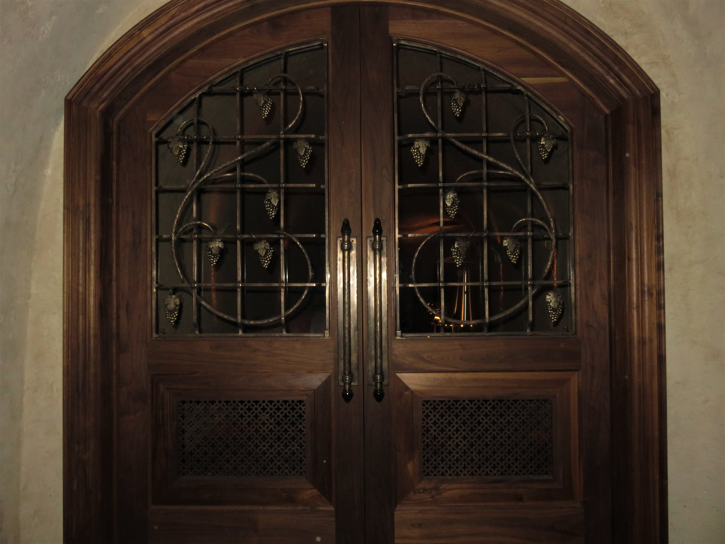 Bronze Grape Vine with Cast Bronze Grapes and Leaves and Cast Bronze Door Pulls with Blown Glass Accents