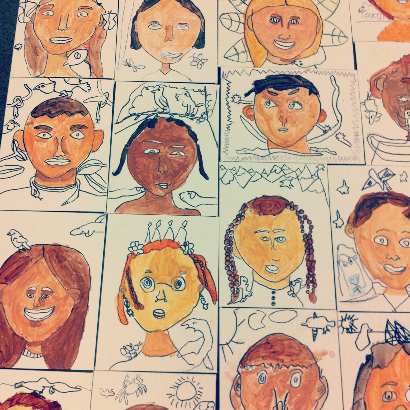first grade self-portraits after our first painting session
