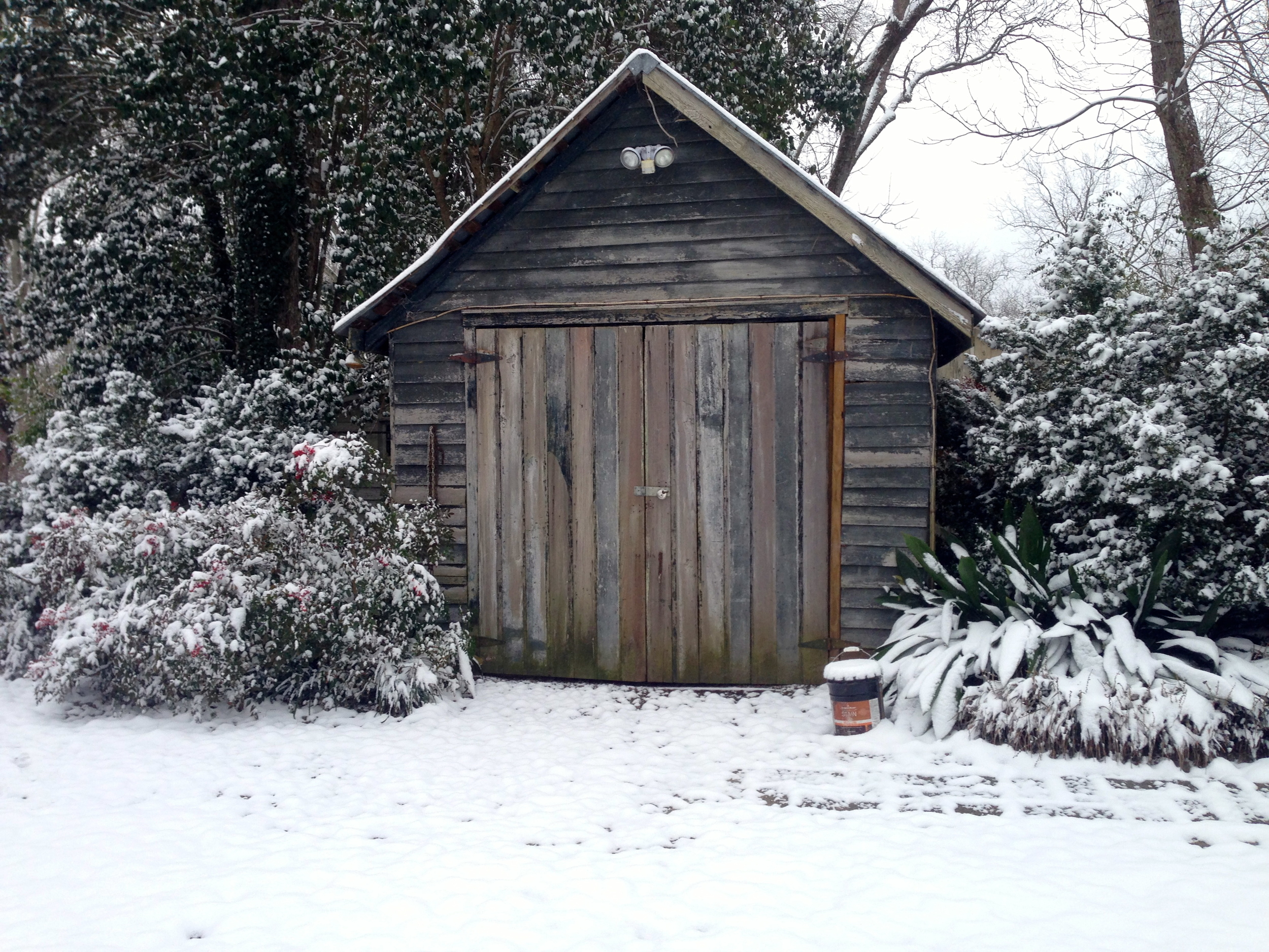 The old tool shed has its act cleaned up by the snow.