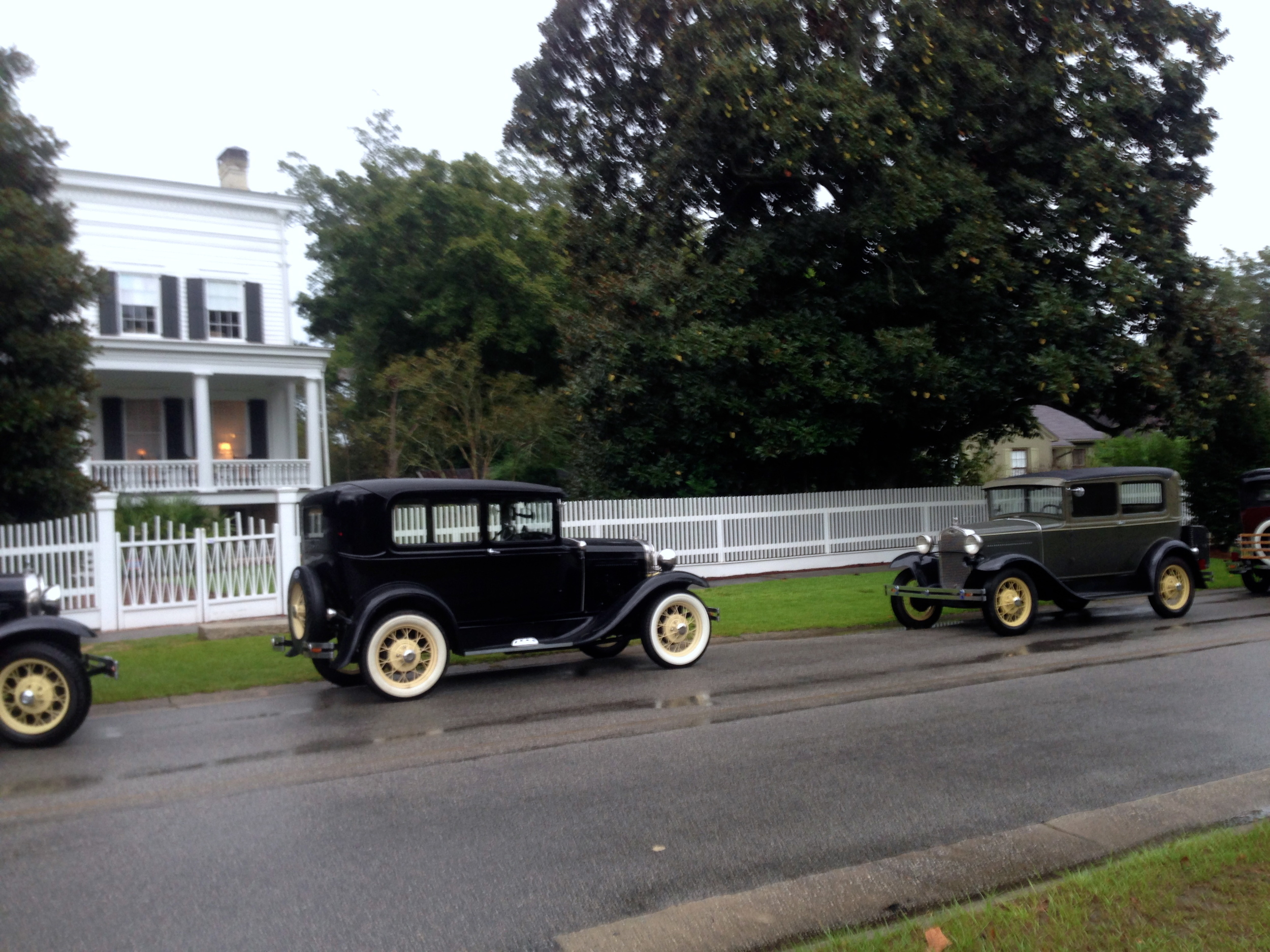 On a wet evening Elm Street becomes lined with the old cars.