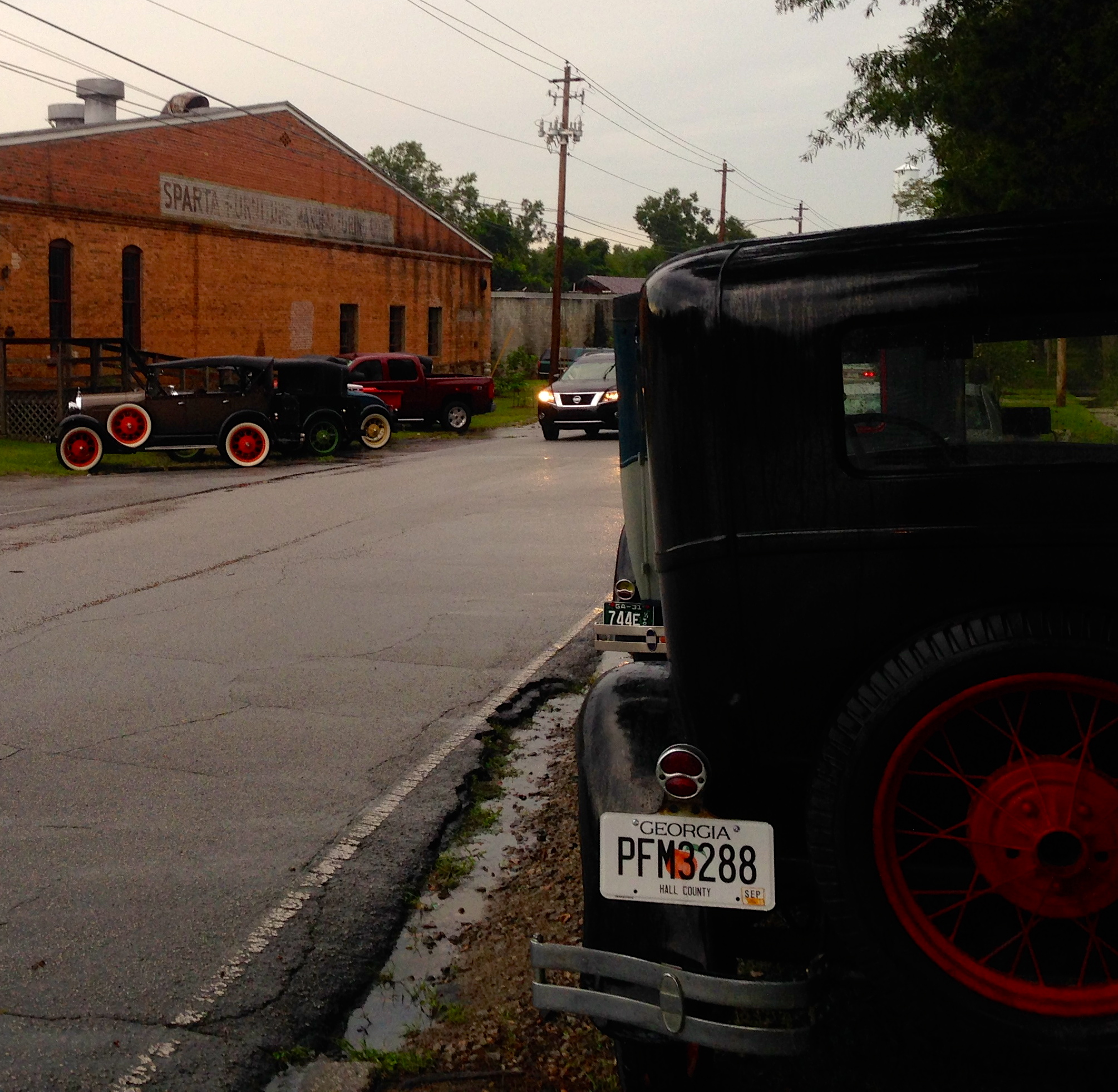 There were a few of the cars parked by the side of the house and by the old cotton warehouse building where Sparta Mushrooms are raised.