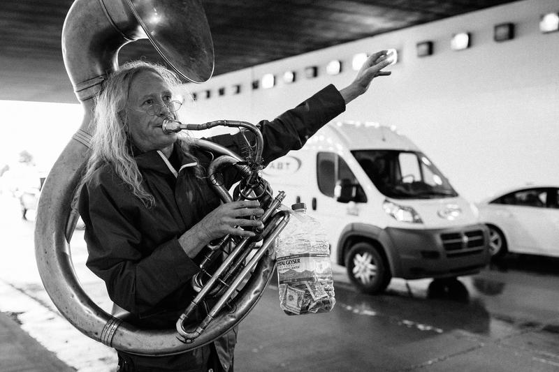 Joe Hunter plays sousaphone during rush hour in a busy tunnel on Thompson Lane in Nashville, Tenn.