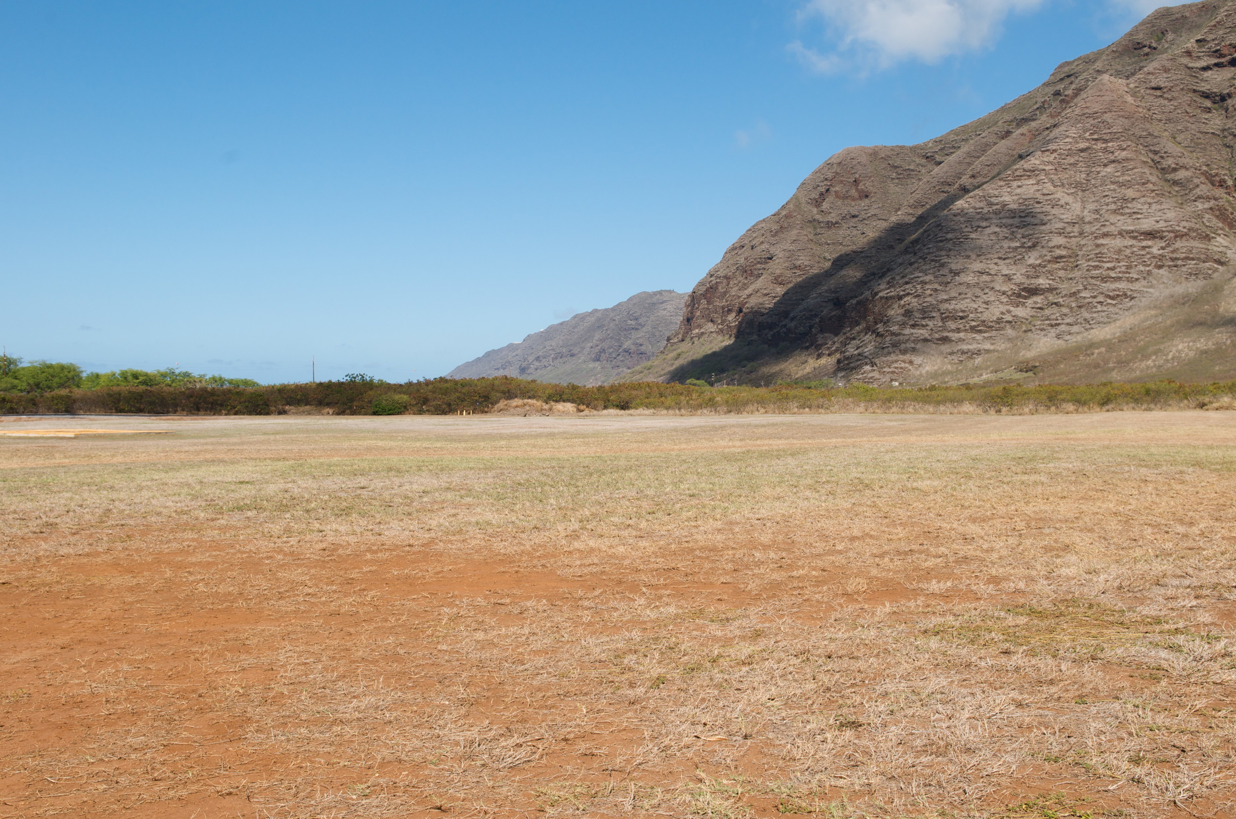 The view towards Kaena point, once one of the most abundant areas for fishing on Oahu. Today, the full extent of the contamination of this area's lands and water are still unknown - based on recent discoveries, the U.S. military's modus operandi has been to deny wrongdoing or responsibility until someone can produce a mountain-sized pile of incriminating evidence and documentation.