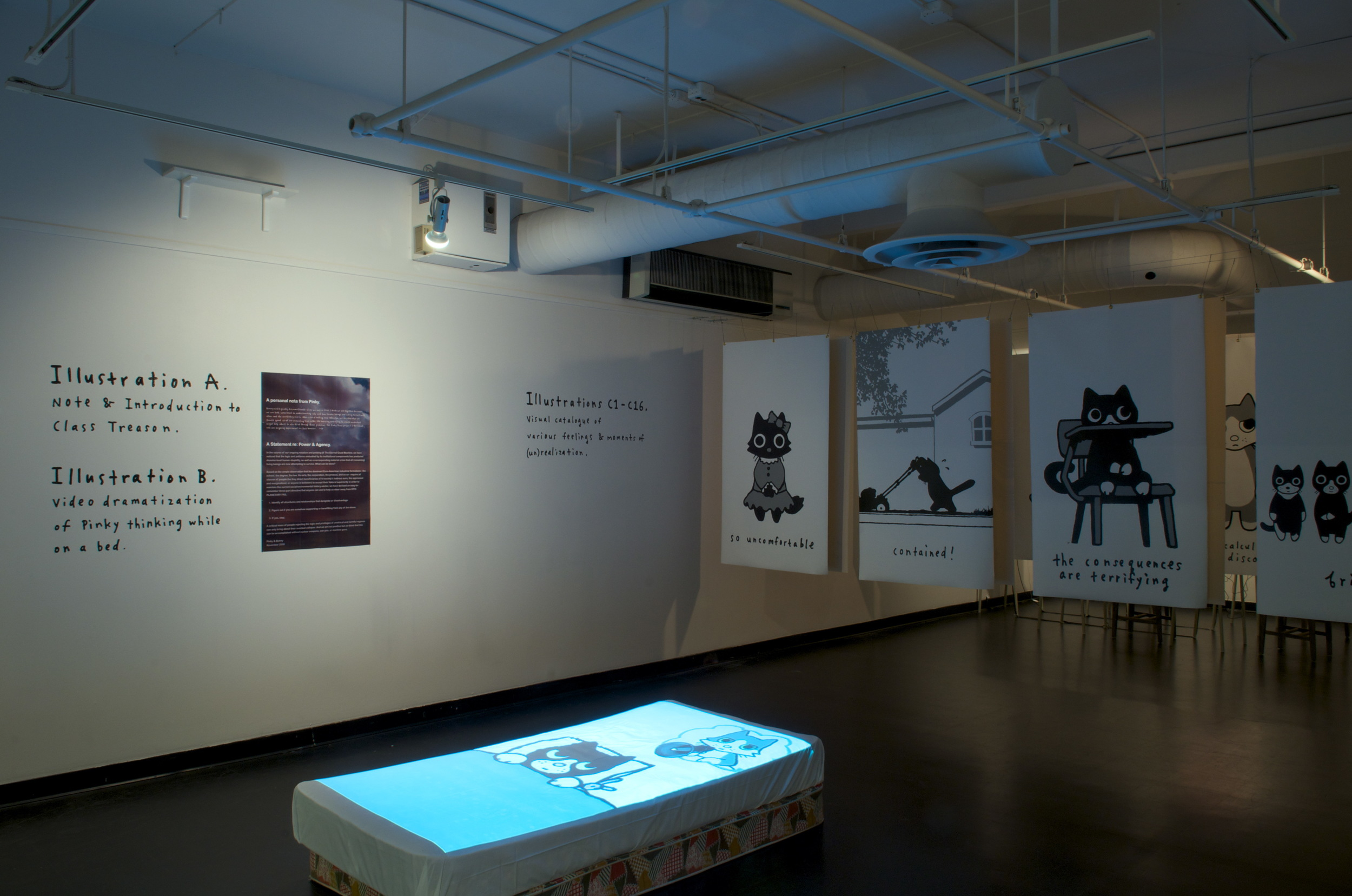 The entry area to the Class Treason Stories installation, University of Winnipeg's 1C03 Gallery. The video projected on the bed is a variant of our Power, Structure, Agency video. The hand-painted banners hanging from the ceiling are each 3 x 5 feet.    Special thanks to curator Milena Placentile and artist Glen Johnson for their help.