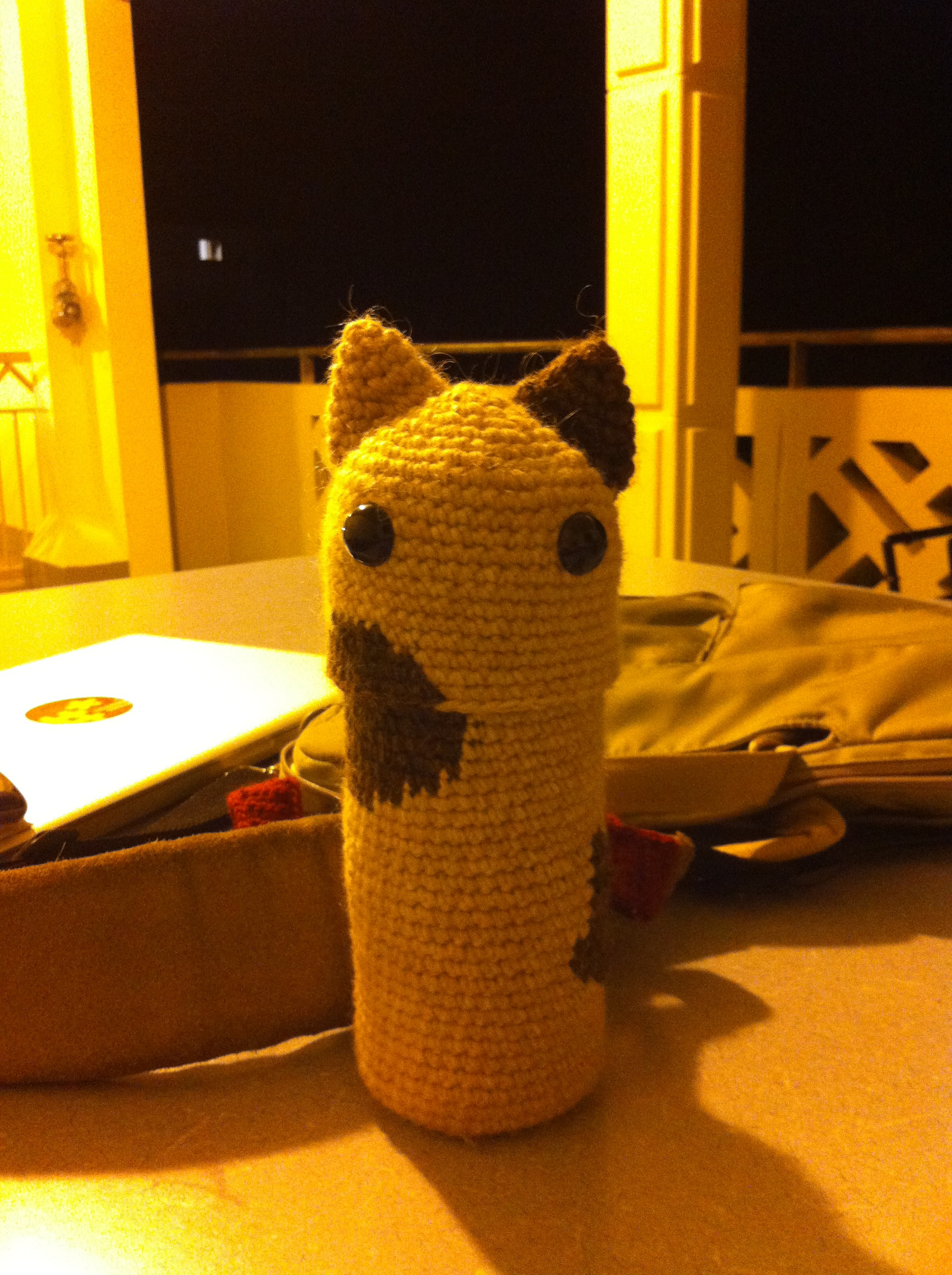 Water Cat's head flips back and then you can drink from it. It also has a crocheted carrying strap and a floppy cat tail in the back that you can't see from this angle.