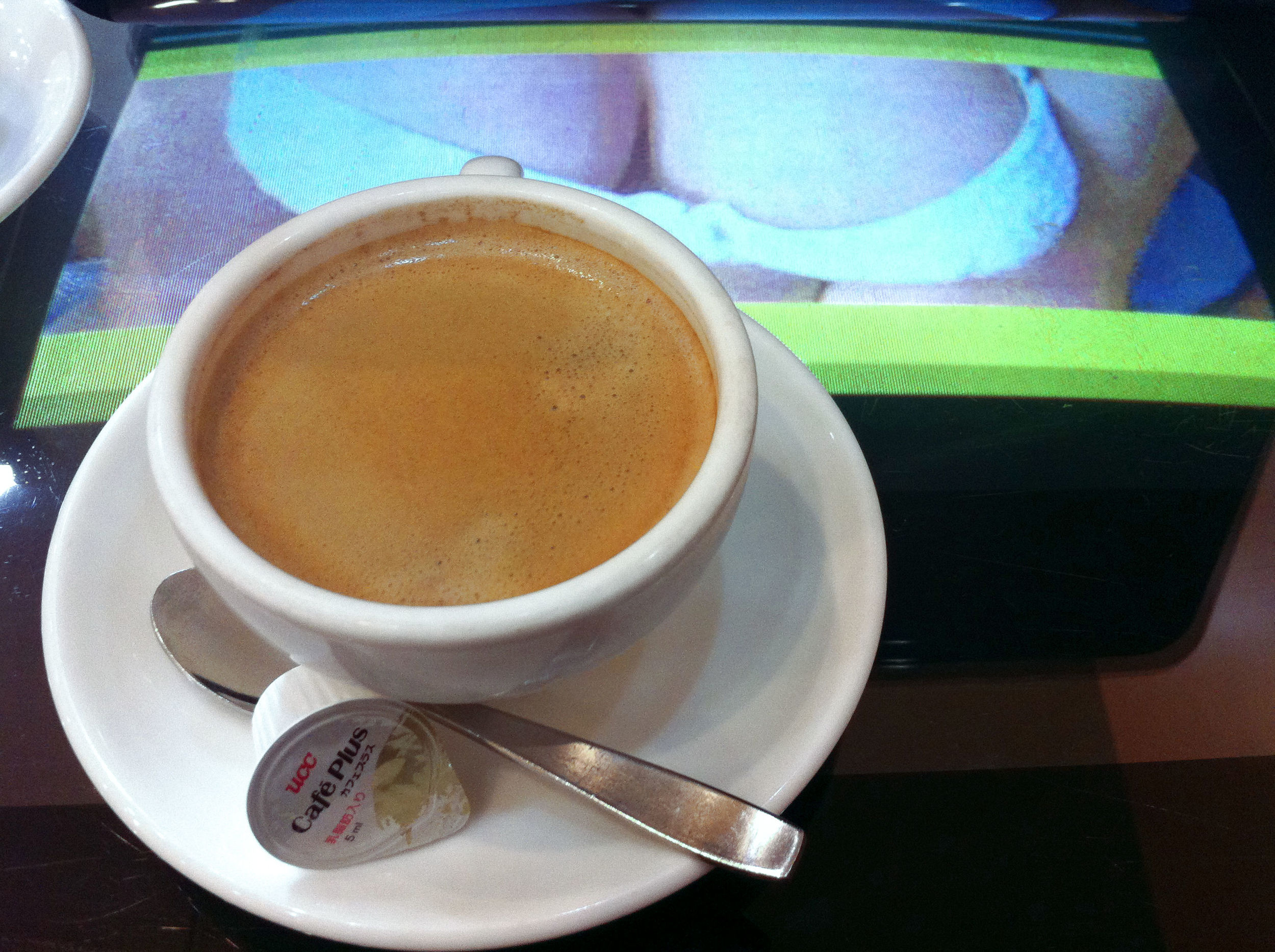 Kind of hard to concentrate on drinking my coffee with boobs and panty shots on continuous video loop under the glass tabletop...