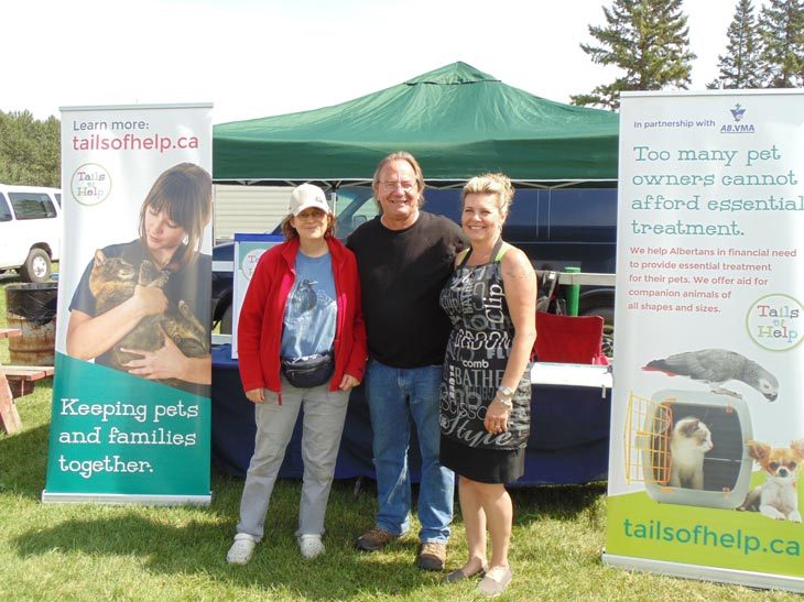 At the Tails of Help booth: Tails volunteer lead Jackie Simmonds, with Edmonton Kennel Club president Paul Bagnall and commercial vendors coordinator Shannon Grabill (click photo to view full size)