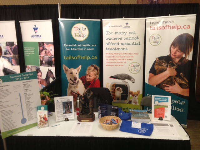 Tails of Help booth at CanWest 2014 Conference Trade Fair