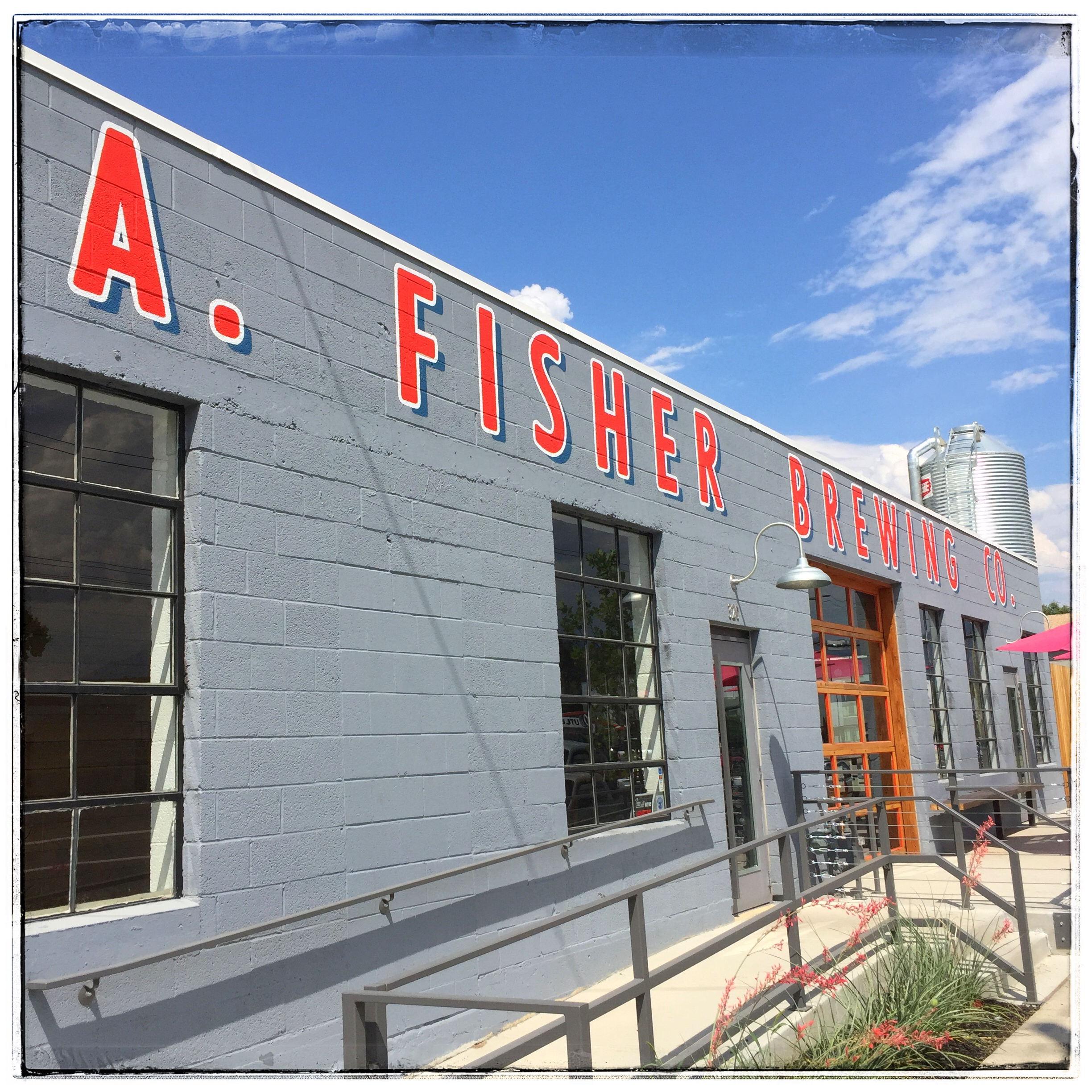 Fisher Brewing Street View - The brewery / taproom has an industrial look and feel both inside and out. However the staff and beer instantly warm you up to their charm.