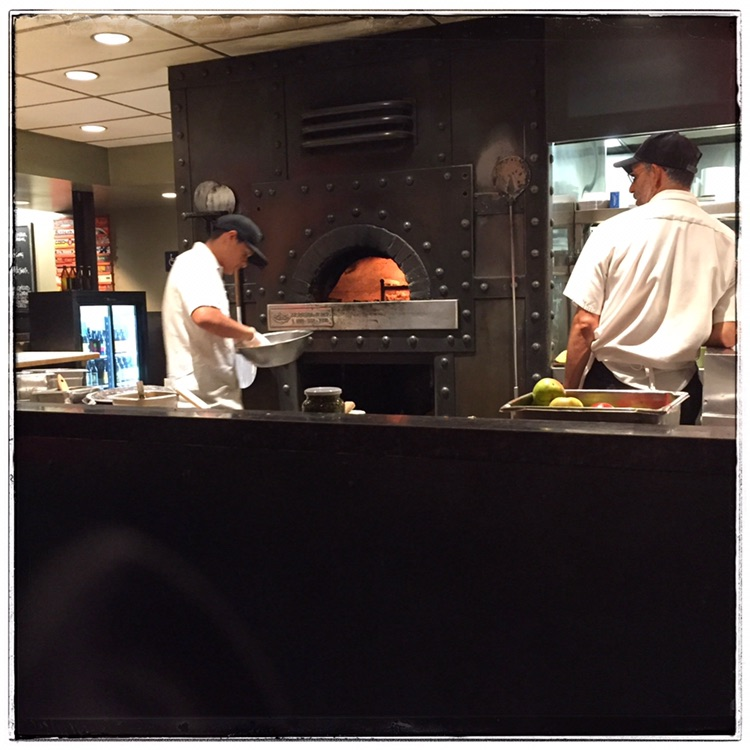 Wood-fired pizza served at Red Rocks