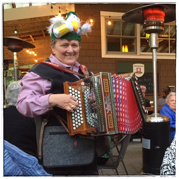Silvia serenades Old Stein Inn guests with her accordion -