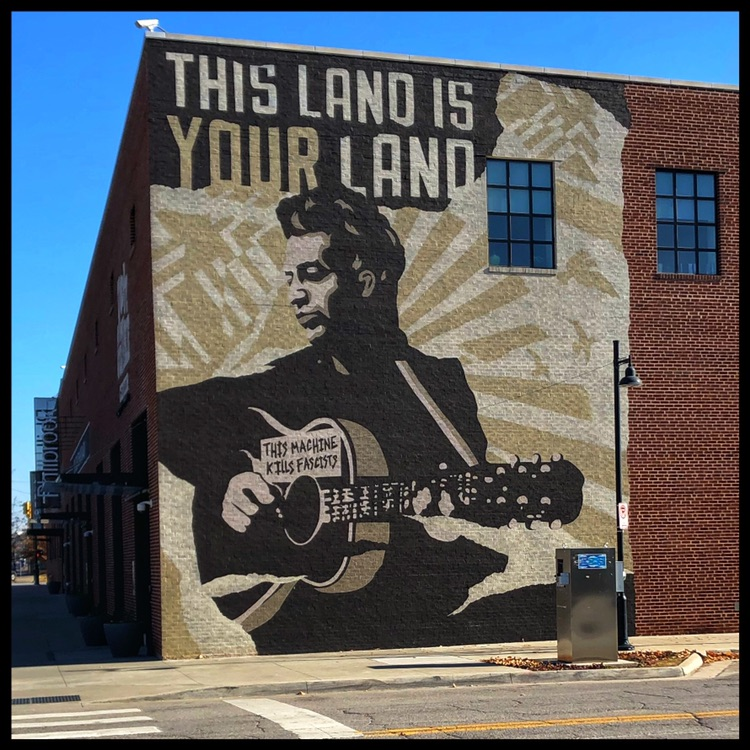 Woody Guthrie Center - This larger than reality mural of Woody Guthrie lets you know are near the music center named after him.