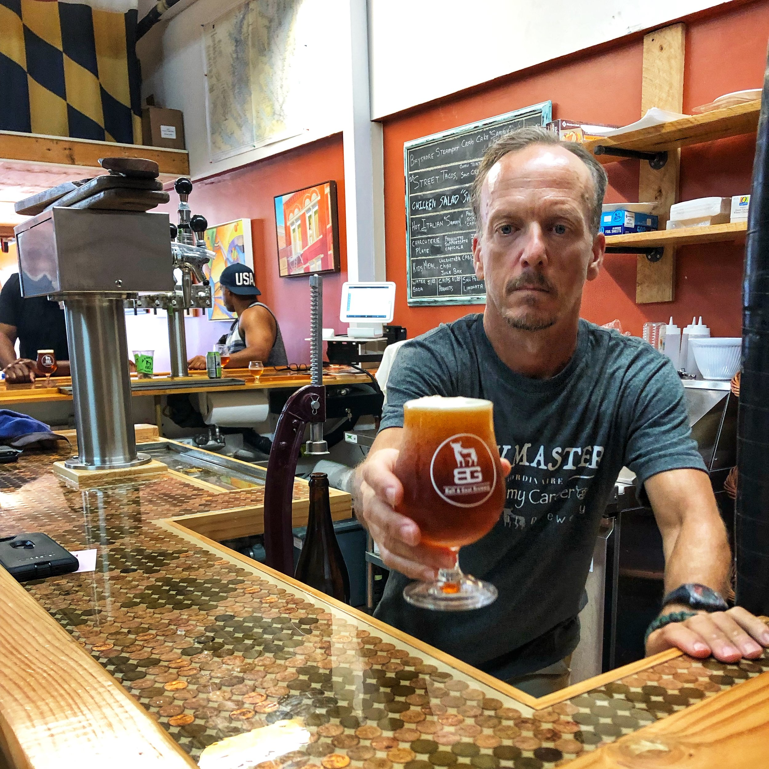 Jeff Putnam, Bull & Goat, pours the perfect pint.