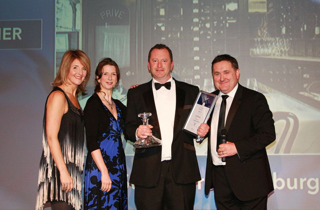 Neil collecting the Sustainable Business of the Year 2014 award