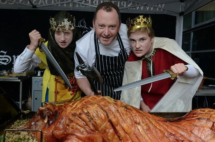 Neil and the pupils get stuck into a hog roast