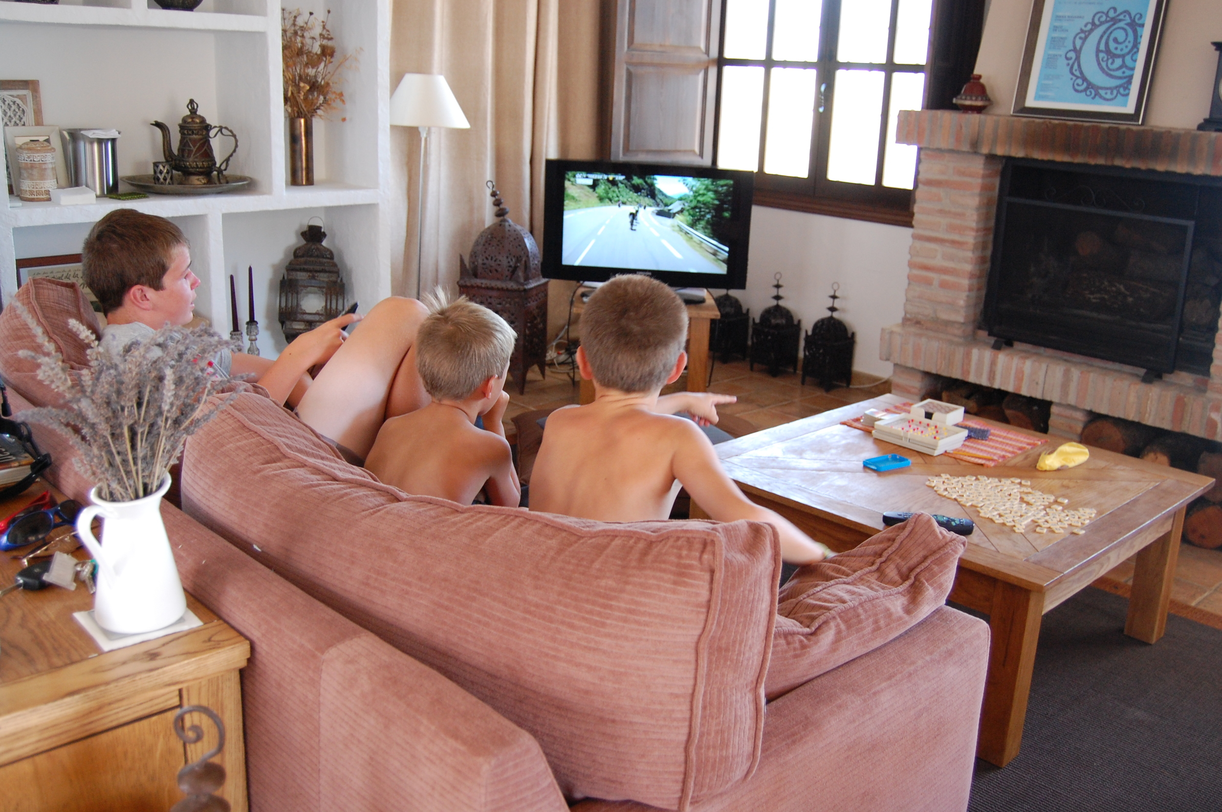 Watching the Tour. Notice games Mommy brought on table.